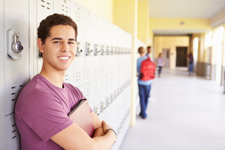 Male High School Student Standing By Lockers Archivio Fotografico