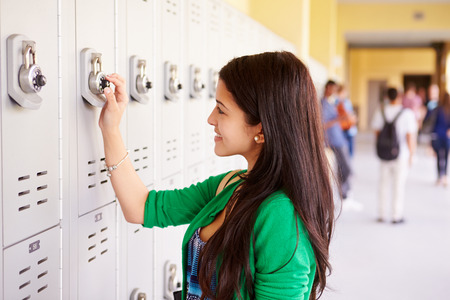 15: Female High School Student Opening Locker