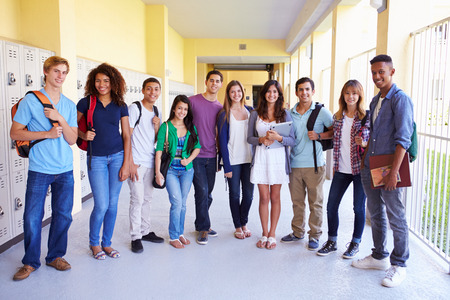Group Of High School Students Standing In Corridor