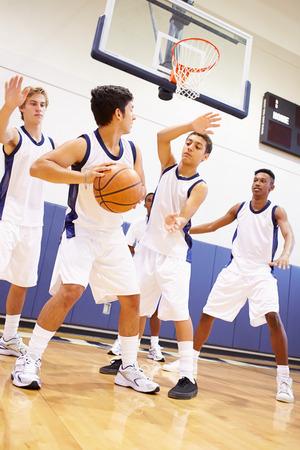 high school basketball: Male High School Basketball Team Playing Game