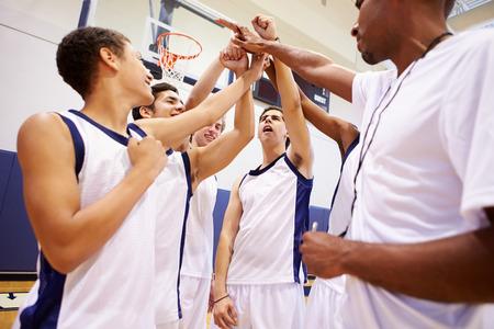basketball team: Male High School Basketball Team Having Team Talk With Coach Stock Photo