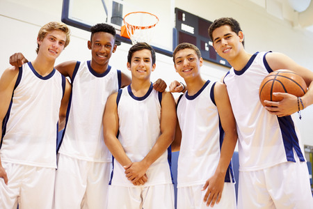 team sports: Members Of Male High School Basketball Team Stock Photo