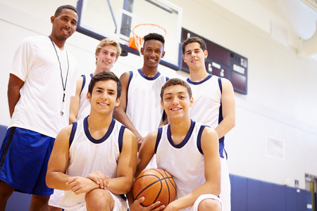 sports team: Members Of Male High School Basketball Team With Coach