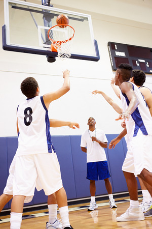 vertical: Male High School Basketball Team Playing Game