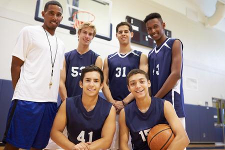 high school basketball: Members Of Male High School Basketball Team With Coach