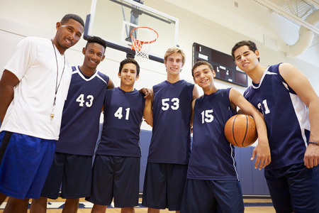 basketball team: Members Of Male High School Basketball Team With Coach