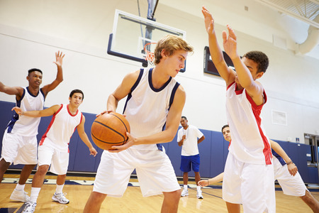 basketball team: Male High School Basketball Team Playing Game