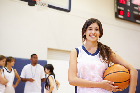 Portrait Of Female High School Basketball Player Stock Photo