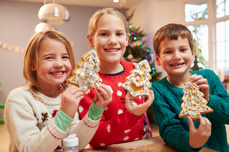 6 7 year old: Three Children Showing Decorated Christmas Cookies