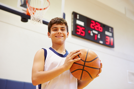high school basketball: Portrait Of Male High School Basketball Player Stock Photo