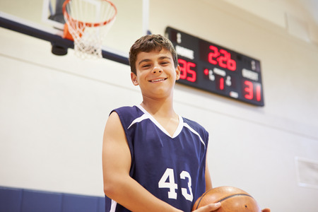 boy basketball: Portrait Of Male High School Basketball Player Stock Photo