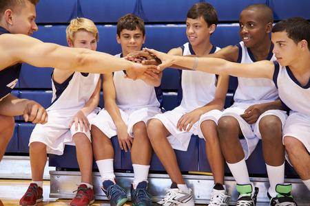 12 13: Male High School Basketball Team Having Team Talk With Coach Stock Photo