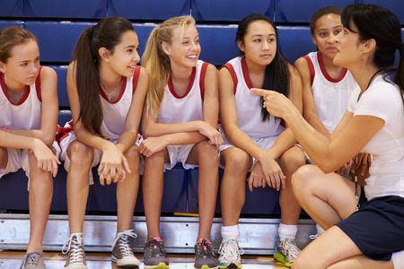 high school basketball: Coach Of Female High School Basketball Team Gives Team Talk
