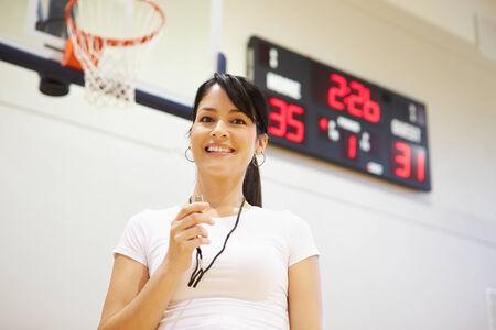 high school basketball: Female Coach Of High School Basketball Team