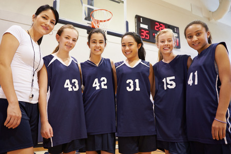 high school basketball: Members Of Female High School Basketball Team With Coach Stock Photo