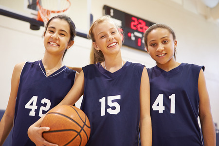gymnasium: Members Of Female High School Basketball Team
