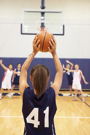 high school basketball: Female High School Basketball Player Shooting Basket Stock Photo