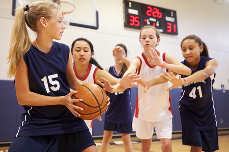 gymnasium: Female High School Basketball Team Playing Game Stock Photo