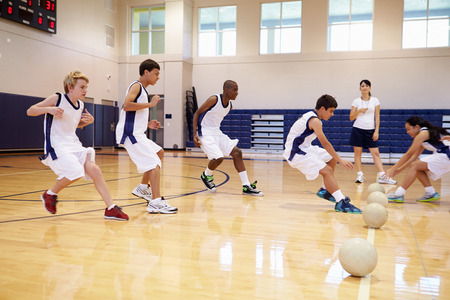 12 13: High School Students Playing Dodge Ball In Gym