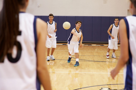 dodge: High School Students Playing Dodge Ball In Gym