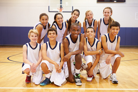 Portrait Of High School Sports Team In Gym photo