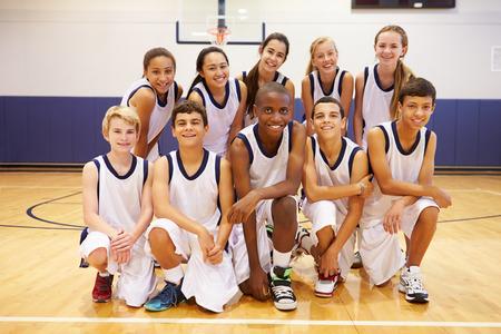 high school sports: Portrait Of High School Sports Team In Gym