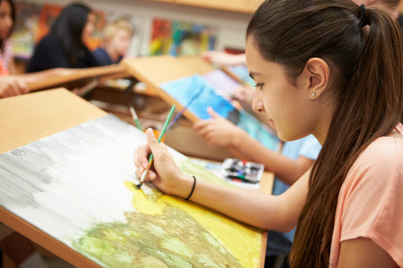 high school girl: Female Pupil In High School Art Class Stock Photo