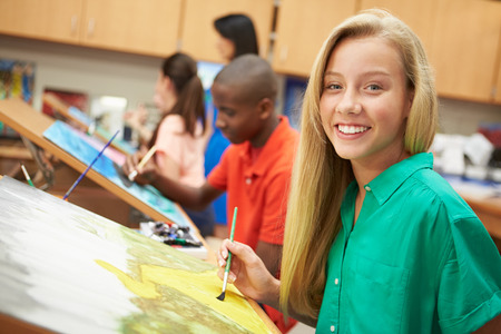 five years old: Female Pupil In High School Art Class Stock Photo