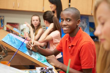Male Pupil In High School Art Class Stock Photo