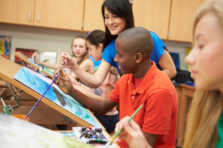 教師と高校の美術の授業で男子生徒 写真素材