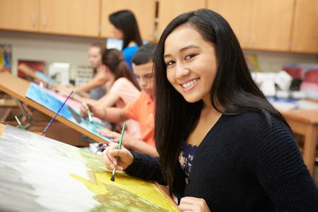 12 class: Female Pupil In High School Art Class Stock Photo