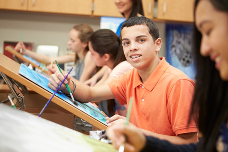 'face painting': Male Pupil In High School Art Class Stock Photo