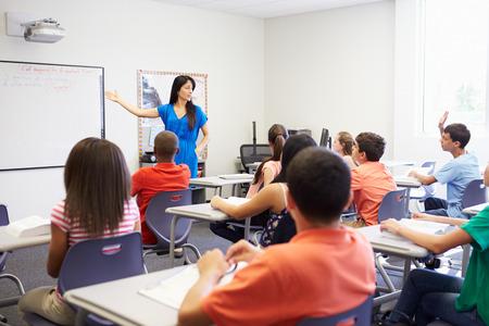 Female High School Teacher Taking Class