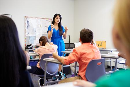 asian teacher: Female High School Teacher Taking Class