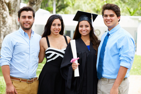 girl portrait: Hispanic Student And Family Celebrating Graduation Stock Photo