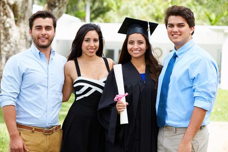 family outdoor: Hispanic Student And Family Celebrating Graduation Stock Photo