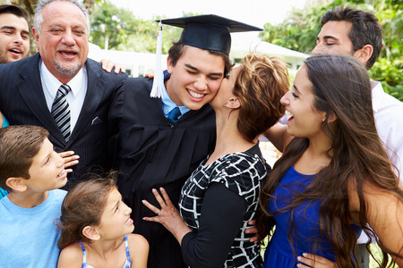 Hispanic Student And Family Celebrating Graduation Stock Photo