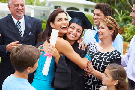 Hispanic Student And Family Celebrating Graduation Stockfoto