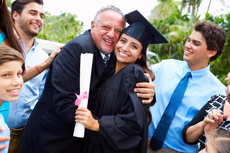 Hispanic Student And Family Celebrating Graduation photo