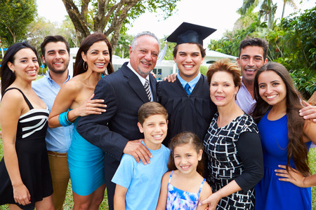 extended family: Hispanic Student And Family Celebrating Graduation Stock Photo