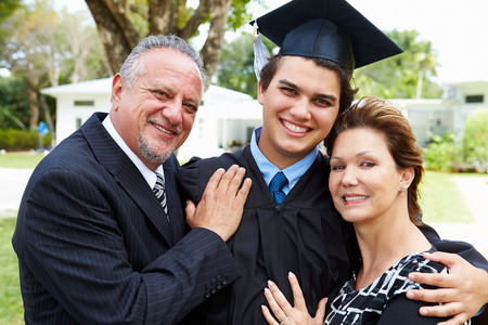 Hispanic Student And Parents Celebrate Graduation