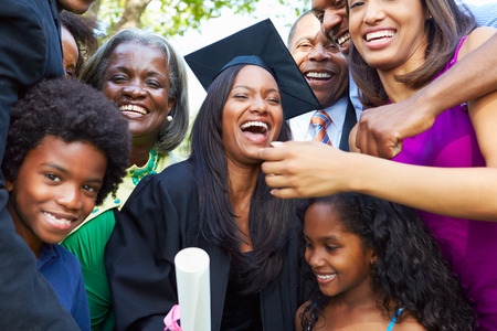extended family: African American Student Celebrates Graduation Stock Photo