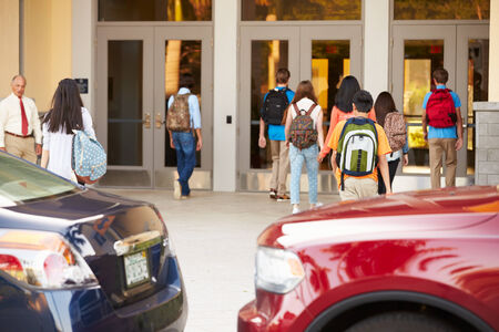 principal: High School Students Being Dropped Off At School By Parents Stock Photo