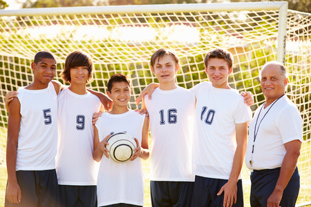 Members Of Male High School Soccer Team With Coach photo