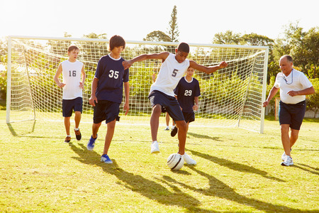 boy: Members Of Male High School Soccer Playing Match