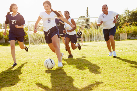 soccer sport: Members Of Female High School Soccer Playing Match