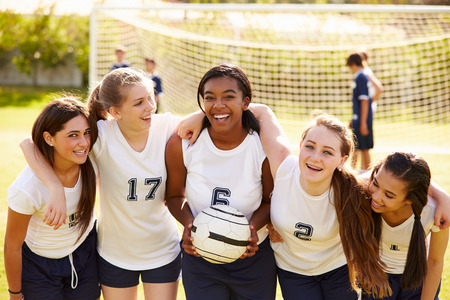 soccer pitch: Members Of Female High School Soccer Team Stock Photo