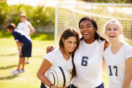 high school girl: Members Of Female High School Soccer Team Stock Photo