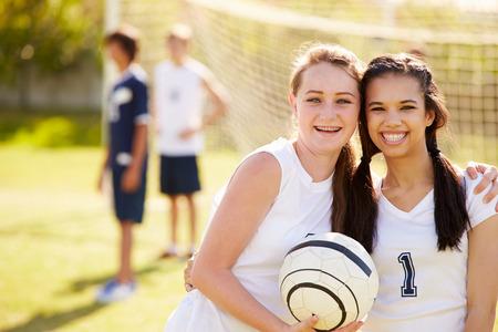 school sports: Members Of Female High School Soccer Team Stock Photo
