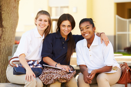 Female High School Students Hanging Out On School Campus